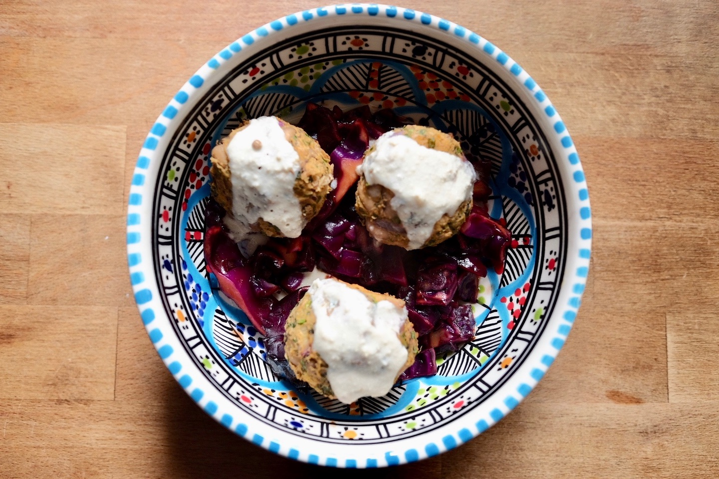 baked blackeye bean balls with red cabbage and a tahini dressing
