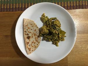 Stuffed chapati with a spicy curry