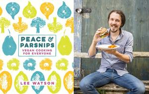 Lee with his vegan burger and his cook book