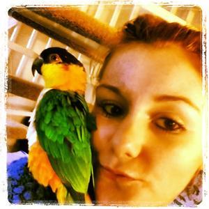Nikki with parrot