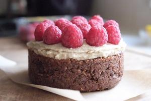 Orange seed cake with cashew nut cream and raspberries