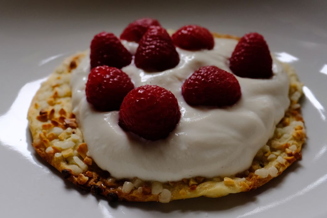 tortas biscuits with soya yogurt and fresh raspberries